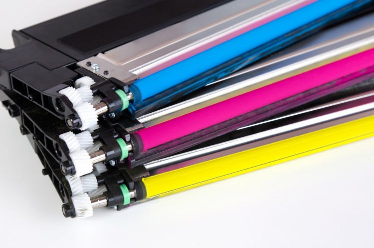 Toner cartridges in pink, blue, and yellow