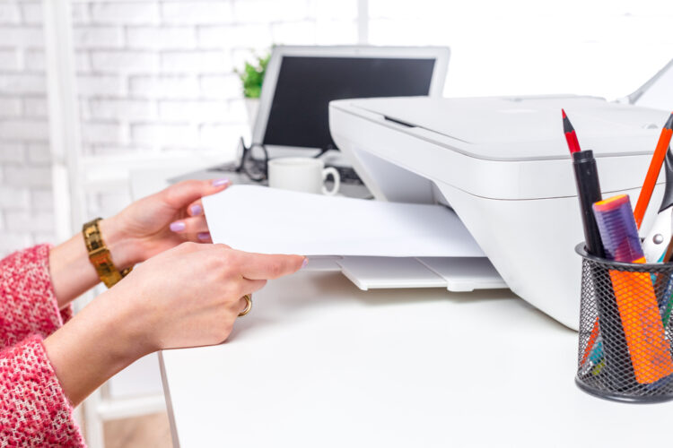 hands setting up printer with google drive