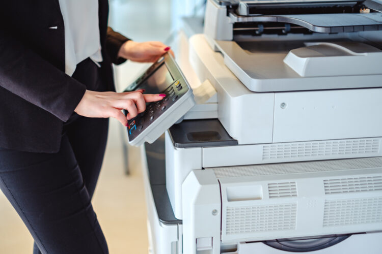 woman struggling with copier Repair Issues